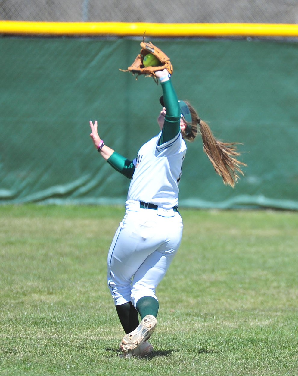 Yavapai's Brianna Griffiths makes the play in shallow left field as the Roughriders take on the Chandler Gilbert Coyotes Tuesday, March 19, 2018 in Prescott.