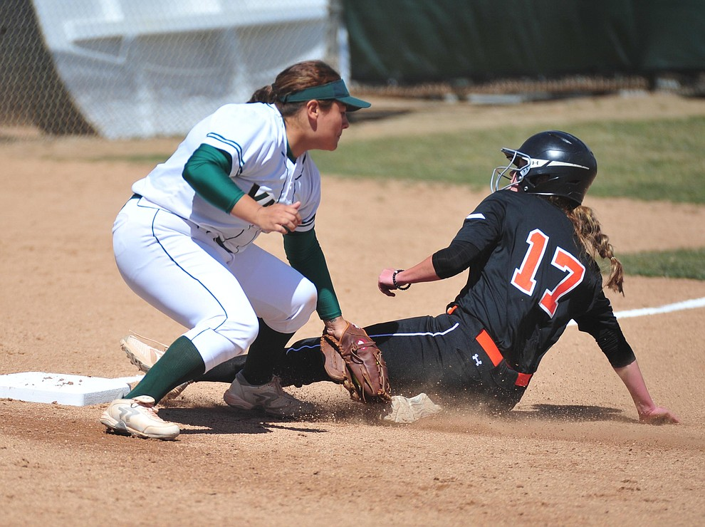 Yavapai's Alexus Garza tries to make the tag at third as the Roughriders take on the Chandler Gilbert Coyotes Tuesday, March 19, 2018 in Prescott.