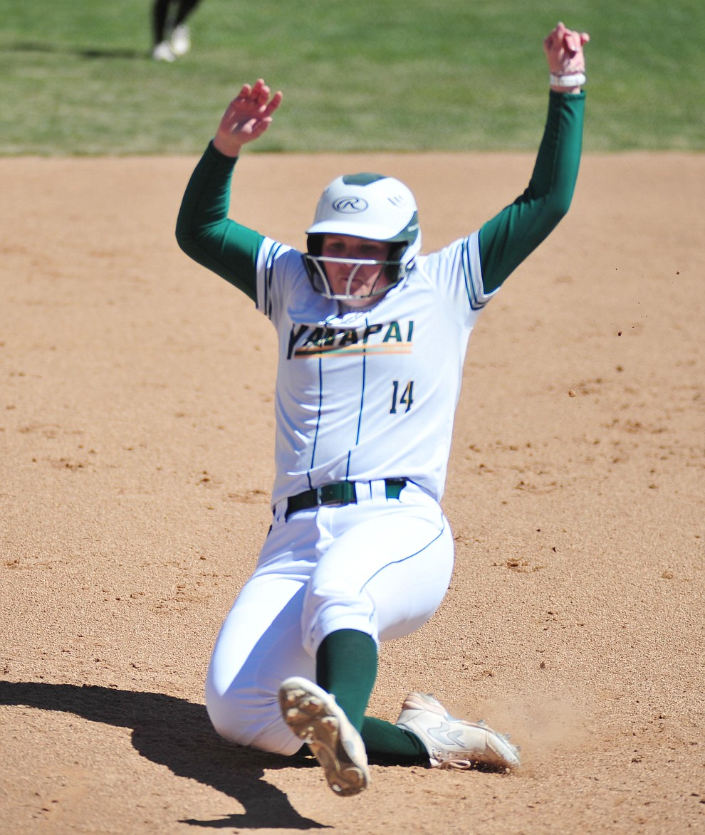Yavapai's Meredith Clark slides safely into third as the Roughriders take on the Chandler Gilbert Coyotes Tuesday, March 19, 2018 in Prescott.