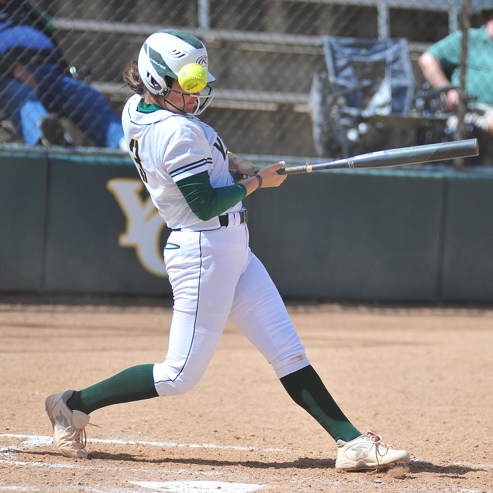 Yavapai's Jessica Giacoma takes a foul ball off her helmet as the Roughriders take on the Chandler Gilbert Coyotes Tuesday, March 19, 2018 in Prescott.