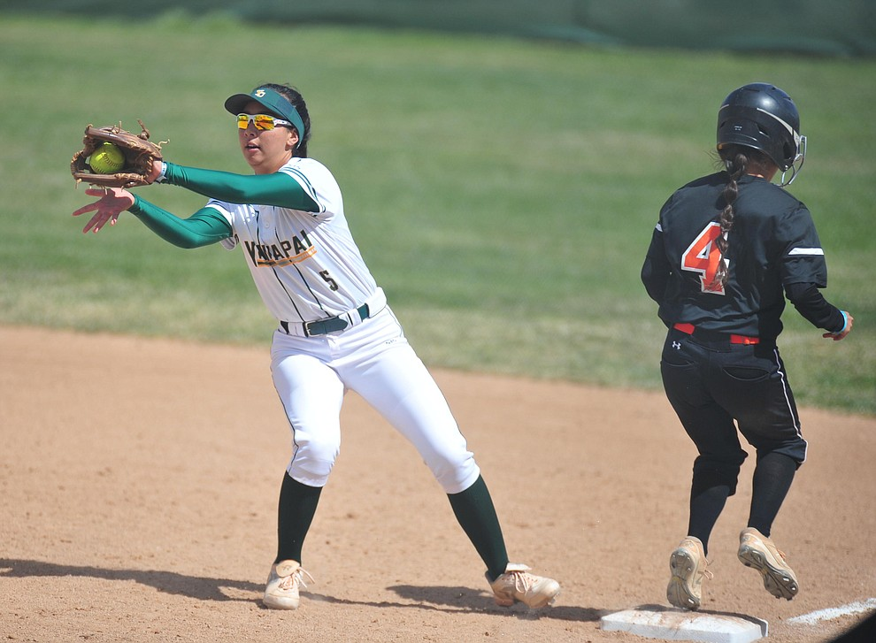 Yavapai's Shaylee Alani tries to make the play at first as the Roughriders take on the Chandler Gilbert Coyotes Tuesday, March 19, 2018 in Prescott.
