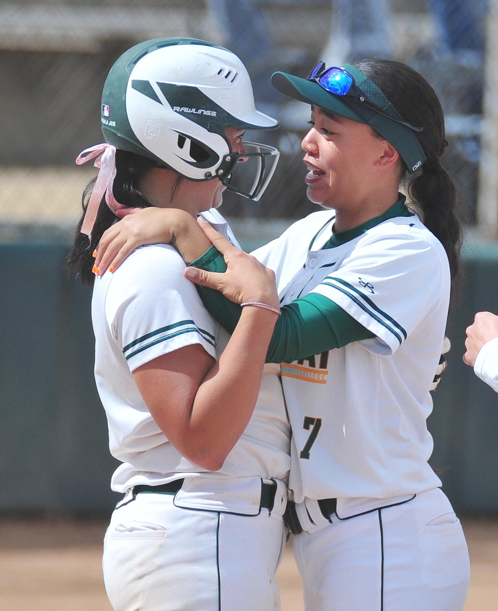 Yavapai's Kylie Brown gets congratulated by Neenah Pangilinan after Brown's two-run walk off homer in the first game of a double header against the Chandler Gilbert Coyotes Tuesday, March 19, 2018 in Prescott.