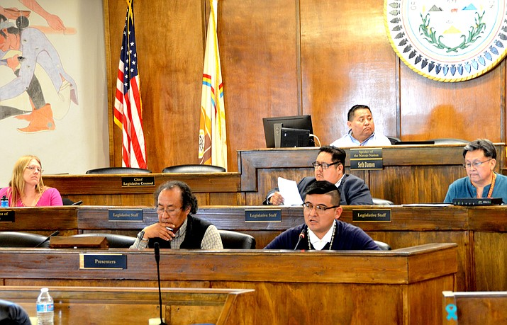 Sitting to the right of the presenter's podium, JT. T. Willie, an appointee executive director of the Navajo Division of Economic Development gives testimony in a committee hearing before the Naabik'íyáti' Committee. (Navajo Nation Council)