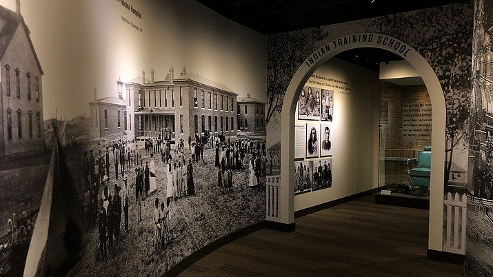 "In a hallway leading to ""Away From Home,"" a panorama depicts the history of American Indian boarding schools across the country. (Photo by Julian Hernandez/Cronkite News)"