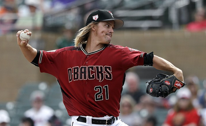 Arizona Diamondbacks starting pitcher Zack Greinke throws against the Cleveland Indians in the first inning of a spring training game Thursday, March 7, 2019, in Scottsdale. The Diamondbacks are hoping to compete for a playoff spot even with one of baseball's best players on a new team. (Elaine Thompson/AP, File)