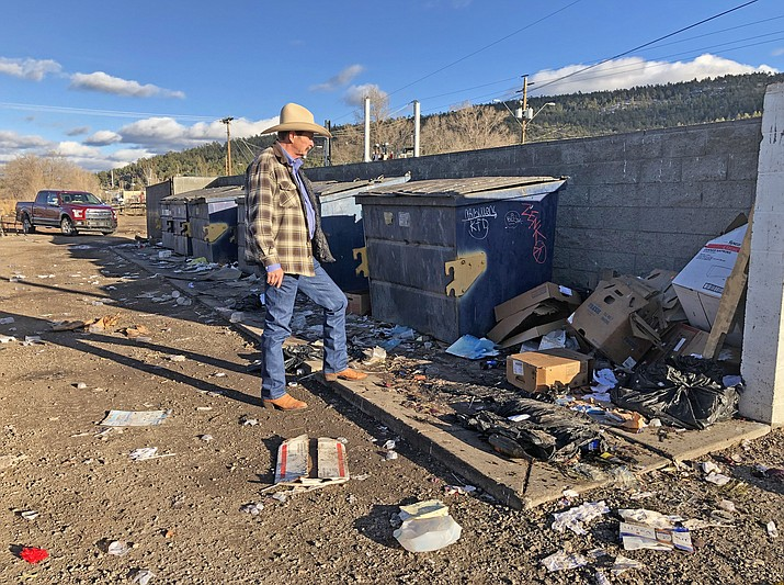 Mayor John Moore looks at the waste problem at city dumpsters in downtown Williams.  (Wendy Howell/WGCN)