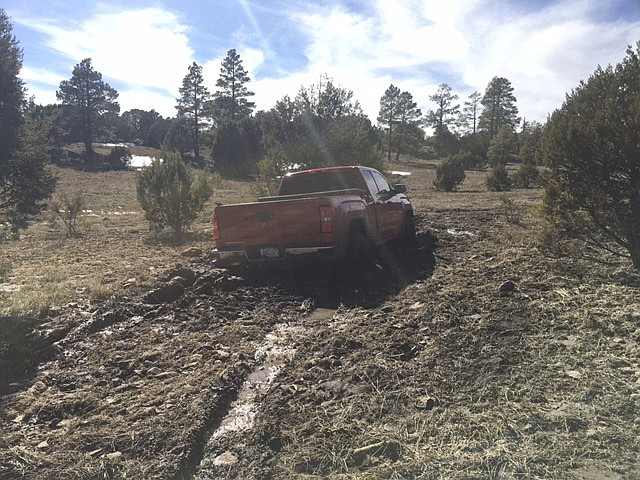 This March 2019 photo provided by the Coconino County Sheriff's Office shows a vehicle belonging to Ryan Long near Happy Jack. Long, 38, who likely died from exposure while stranded in Arizona might have survived if he had not rejected rescue efforts because he was afraid of being arrested, authorities said Tuesday, March 19, 2019. (Coconino County Sheriff's Office via AP)