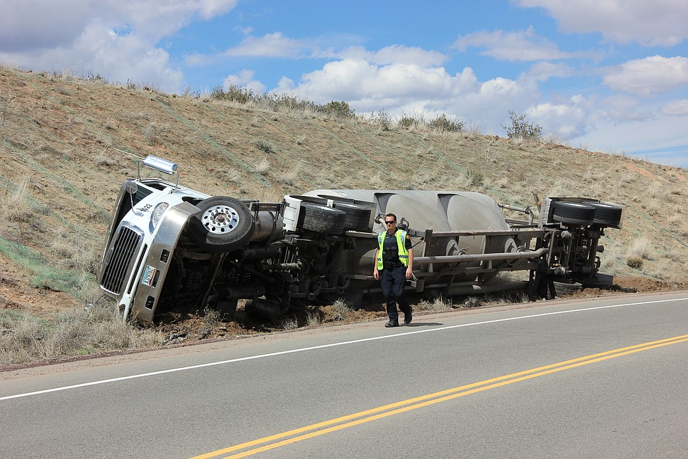 Prescott Police Department officers respond to a vehicle accident where a cement truck tipped over along Deep Well Ranch Road Tuesday, March 19, 2018 in Prescott. (Max Efrein/Courier)