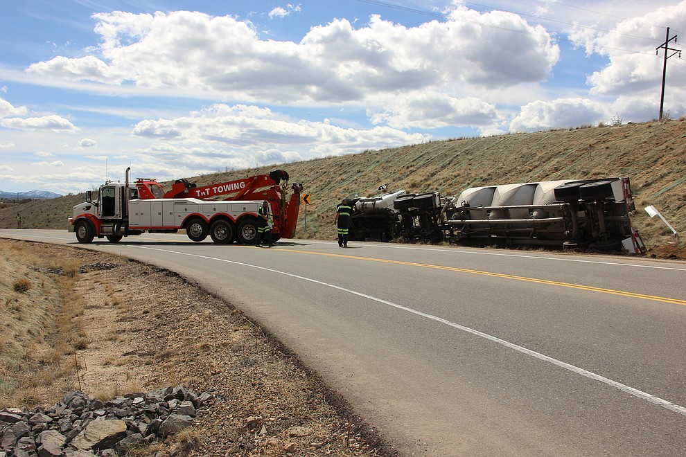 TNT Towing arrives at the scene of a vehicle accident on Deep Well Ranch Road in Prescott where a cement truck tipped onto its side Tuesday, March 19, 2018. (Max Efrein/Courier)