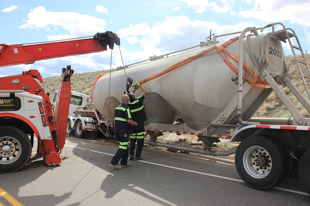 After nearly two hours of problem solving, a towing crew from TNT Towing managed to right a tipped cement truck along Deep Well Ranch Road in Prescott midday Tuesday, March 19. (Max Efrein/Courier)