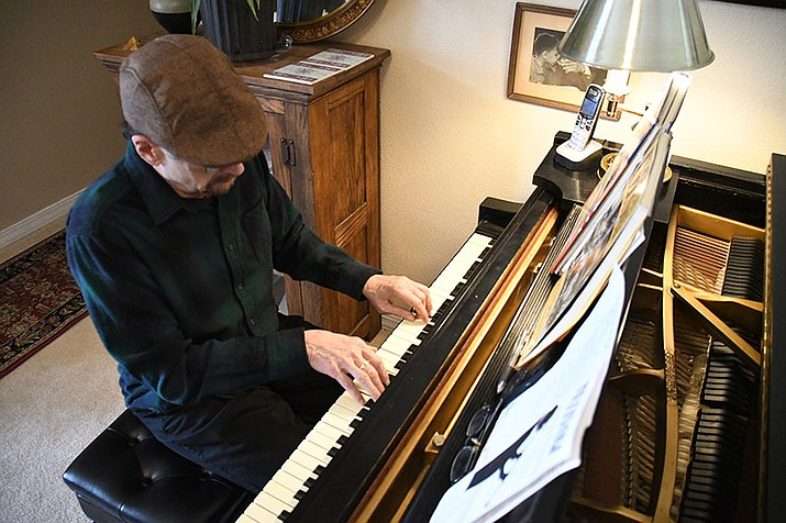 Mike Lipskin plays a stride jazz piece on his piano at his home. Lipskin and vocalist Dinah Lee are performing 7 - 8:30 p.m. Saturday at the Kingman Center for the Arts Gallery, 208 E. Beale St. (Photo by Vanessa Espinoza/Daily Miner)