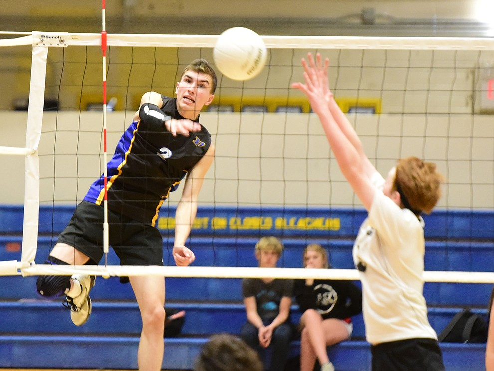 Prescott's Cole Fernandez sends a kill to the back line as the Badgers hosted Leading Edge Wednesday, March 20, 2019 in Prescott. (Les Stukenberg/Courier)