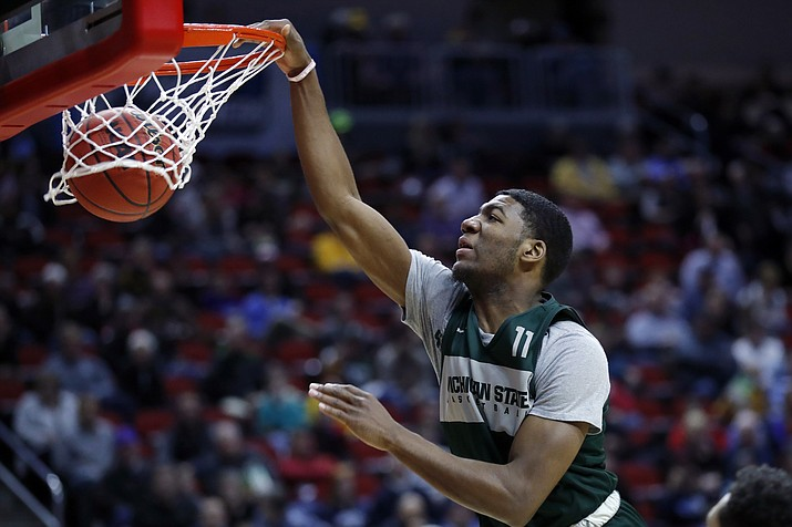 Michigan State forward Aaron Henry dunks the ball during practice at the NCAA men's college basketball tournament, Wednesday, March 20, 2019, in Des Moines, Iowa. Michigan State plays Bradley on Thursday. (Charlie Neibergall/AP)