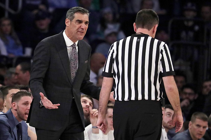 Villanova head coach Jay Wright, left, talks to referee Pat Driscoll during the first half of an NCAA college basketball game against Seton Hall in the championship of the Big East Conference tournament, Saturday, March 16, 2019, in New York. Villanova won 74-72. (Julio Cortez/AP)