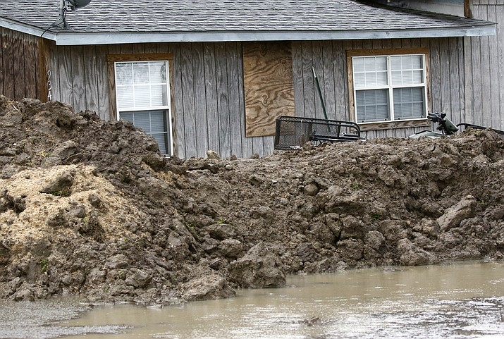This March 11, 2019 photo shows a makeshift levee built by a resident in Rolling Fork, Miss., to protect his home from flood waters. In March 2019, scientists are warning that historic flooding could soon deluge parts of several southern states along the lower Mississippi River, where flood waters could persist for several weeks. (Rogelio V. Solis/AP file)