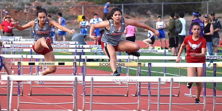 From left, Mingus' Josie Duncan, Estefana Parra and Victoria Skerrett compete in the 100-meter hurdles on Tuesday at the Sedona Friendship Invitational. VVN/James Kelley