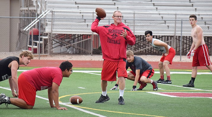 Former Mingus head coach Bob Young throws the football during practice in 2017. VVN/James Kelley