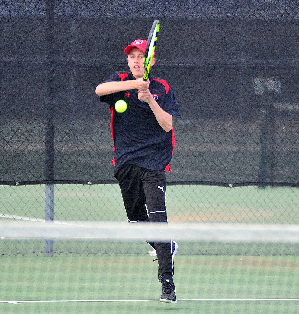 Bradshaw Mountain's Colin Streeter returns a serve as the Bears hosted the Mingus Marauders in Prescott Valley Thursday, March 21, 2019.  (Les Stukenberg/Courier)