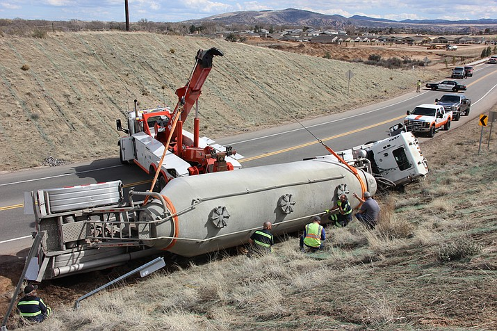 A towing crew works on righting a tipped cement truck along Deep Well Ranch Road in Prescott midday Tuesday, March 19. (Max Efrein/Courier)