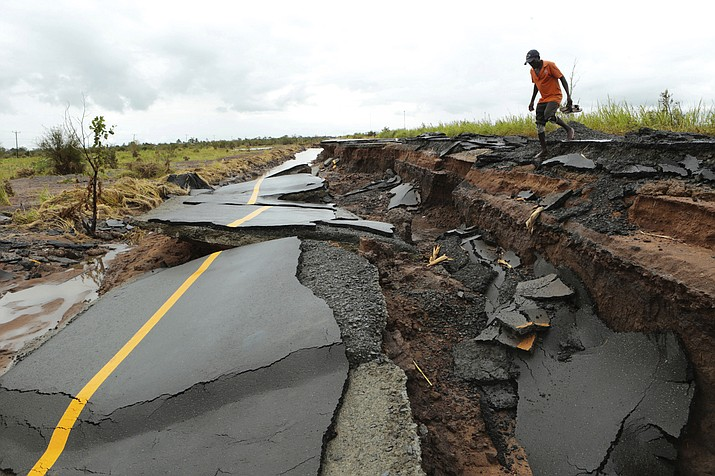A man passes through a section of the road damaged by Cyclone Idai in Nhamatanda about 50 kilometres from Beira, in Mozambique, Friday March, 22, 2019. As flood waters began to recede in parts of Mozambique on Friday, fears rose that the death toll could soar as bodies are revealed. (Tsvangirayi Mukwazhi/AP)