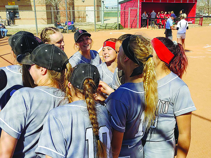 Bradshaw Mountain softball senior captain Shelby Dilcher (middle, red bandanna) rallies her teammates in a pregame huddle for Game 2 of the Bears' doubleheader against Lee Williams on Friday, March 22, in Prescott Valley. (Doug Cook/Courier)
