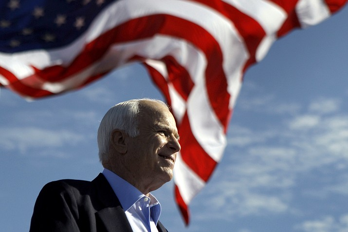 In this Nov. 3, 2008 image, Republican presidential candidate Sen. John McCain, R-Ariz., speaks at a rally outside Raymond James Stadium in Tampa, Fla. President Donald Trump is not backing down from his longstanding criticism of the late Sen. John McCain. Trump drew criticism over the weekend for tweeting insults at McCain, a Vietnam war hero, Arizona senator and 2008 Republican presidential candidate who died last year of brain cancer. (Carolyn Kaster/AP, file)