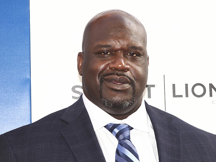 "In this June 26, 2018 photo, Shaquille O'Neal attends the world premiere of ""Uncle Drew"" at Alice Tully Hall in New York. Papa John's has a new pitchman: Shaquille O'Neal. The chain says the basketball Hall of Famer will appear on TV commercials and other advertisements. He will also join the company's board of directors and invest in nine of its restaurants. (Andy Kropa/Invision via AP)"