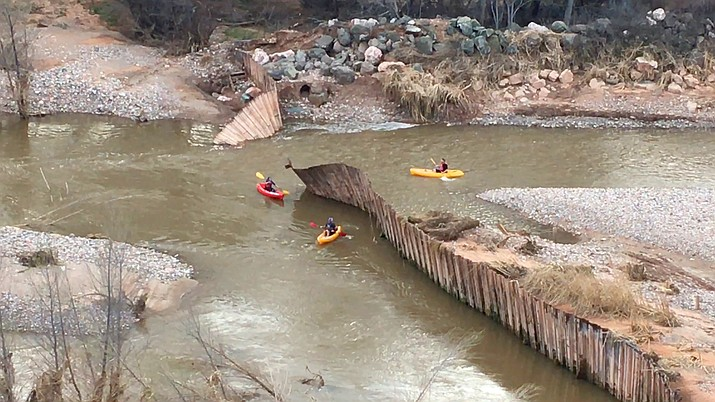Kayakers float past the breached dam in Clarkdale owned by Freeport Minerals. The company does not know when it will remove the damaged dam yet. VVN/Vyto Starinskas