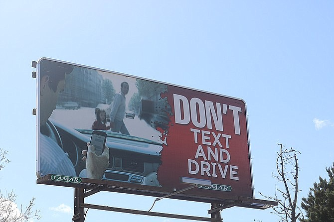 """Don't Text and Drive"" reads the billboard off of Andy Devine Avenue on the way downtown. (Photo by Travis Rains/Daily Miner)"