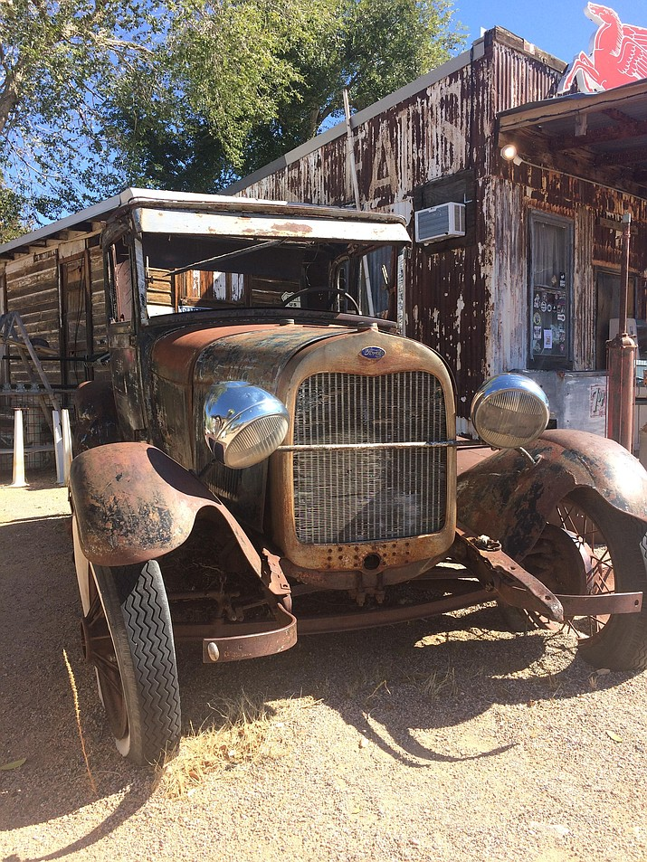 An old Ford stands as a sentry in front of the General Store in Hackberry, Arizona, along Route 66. (Tim Wiederaenders/Courier)