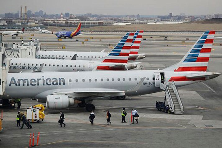American Airlines asked law enforcement to meet Flight 1344 from Chicago once it arrived in Charlotte, North Carolina on Thursday after a drunk passenger urinated on a female passenger's luggage. (LaGuardia Airport AP Photo file photo/Frank Franklin II)