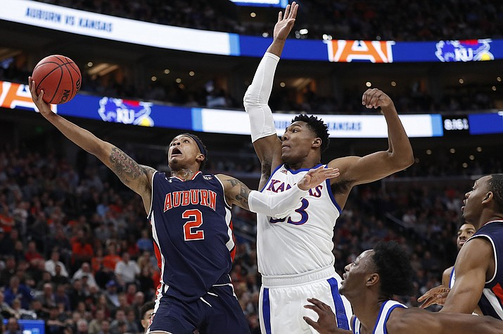 Auburn guard Bryce Brown drives to the basket against Kansas forward David McCormack, right, during a second-round game in the NCAA college basketball tournament Saturday, March 23, 2019, in Salt Lake City. (Jeff Swinger/AP)