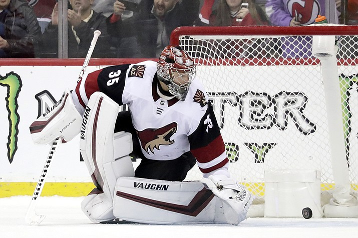 A shootout shot by New Jersey Devils center Pavel Zacha, not visible, of the Czech Republic, gets by Arizona Coyotes goaltender Darcy Kuemper (35) for a goal during an NHL hockey game, Saturday, March 23, 2019, in Newark, N.J. The Devils won 2-1 in a shootout. (Julio Cortez/AP)