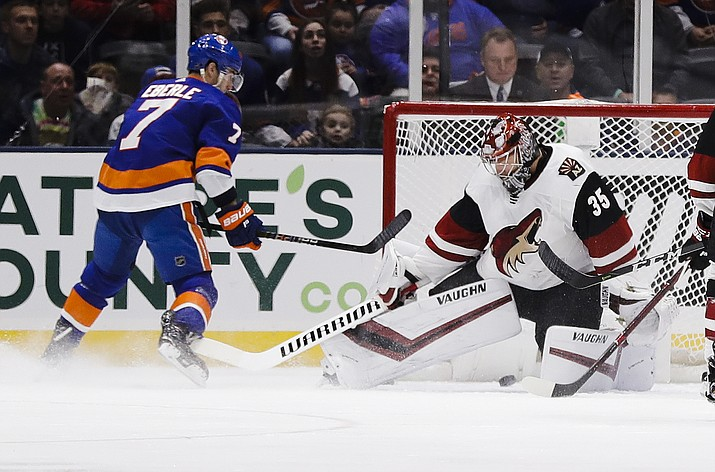 New York Islanders' Jordan Eberle (7) shoots the puck past Arizona Coyotes goaltender Darcy Kuemper (35) during the first period of an NHL hockey game Sunday, March 24, 2019, in Uniondale, N.Y. (Frank Franklin II/AP)