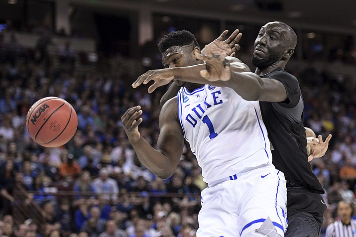 Central Florida center Tacko Fall (24) defends against Duke forward Zion Williamson (1) during the first half of a second-round game in the NCAA men's college basketball tournament Sunday, March 24, 2019, in Columbia, S.C. (Sean Rayford, AP, file)