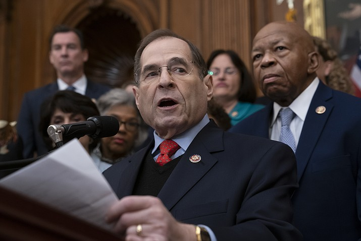 "In this Jan. 4, 2019, file photo, Rep. Jerrold Nadler, D-N.Y., chairman of the House Judiciary Committee, joined at right by Rep. Elijah Cummings, D-Md., chairman of the House Committee on Oversight and Reform, speaks to House Democrats, now in the majority, during an event at the Capitol in Washington. Nadler, Cummings, and House Intelligence Chairman Adam Schiff said in a joint statement, ""The Special Counsel's Report should be allowed to speak for itself, and Congress must have the opportunity to evaluate the underlying evidence."" (J. Scott Applewhite/AP, file)"