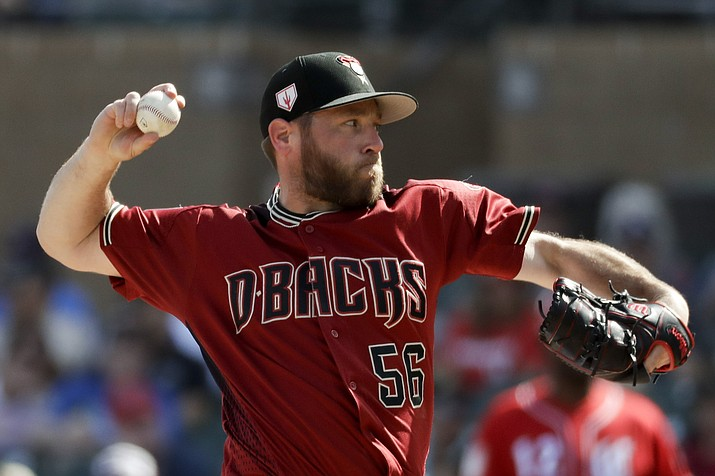 Arizona Diamondbacks relief pitcher Greg Holland throws against the Cincinnati Reds during the fourth inning of a spring baseball game in Scottsdale, Ariz., Monday, March 4, 2019. Holland was named the closer for the Diamondbacks on Monday, March 25. (Chris Carlson/AP, file)