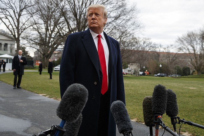 President Donald Trump listens to a question as he speaks with reporters before boarding Marine One on the South Lawn of the White House, Friday, March 22, 2019, in Washington. (Evan Vucci/AP)
