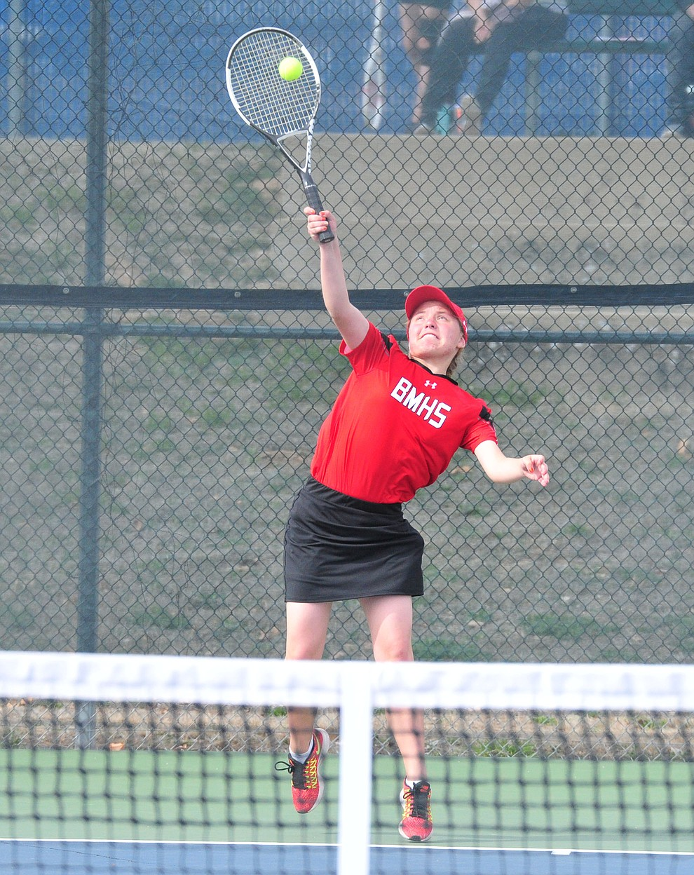 Bradshaw Mountain's Rachel Supergan serves as the Bears traveled to Prescott for a girls tennis matchup Tuesday, March 26. (Les Stukenberg/Courier)