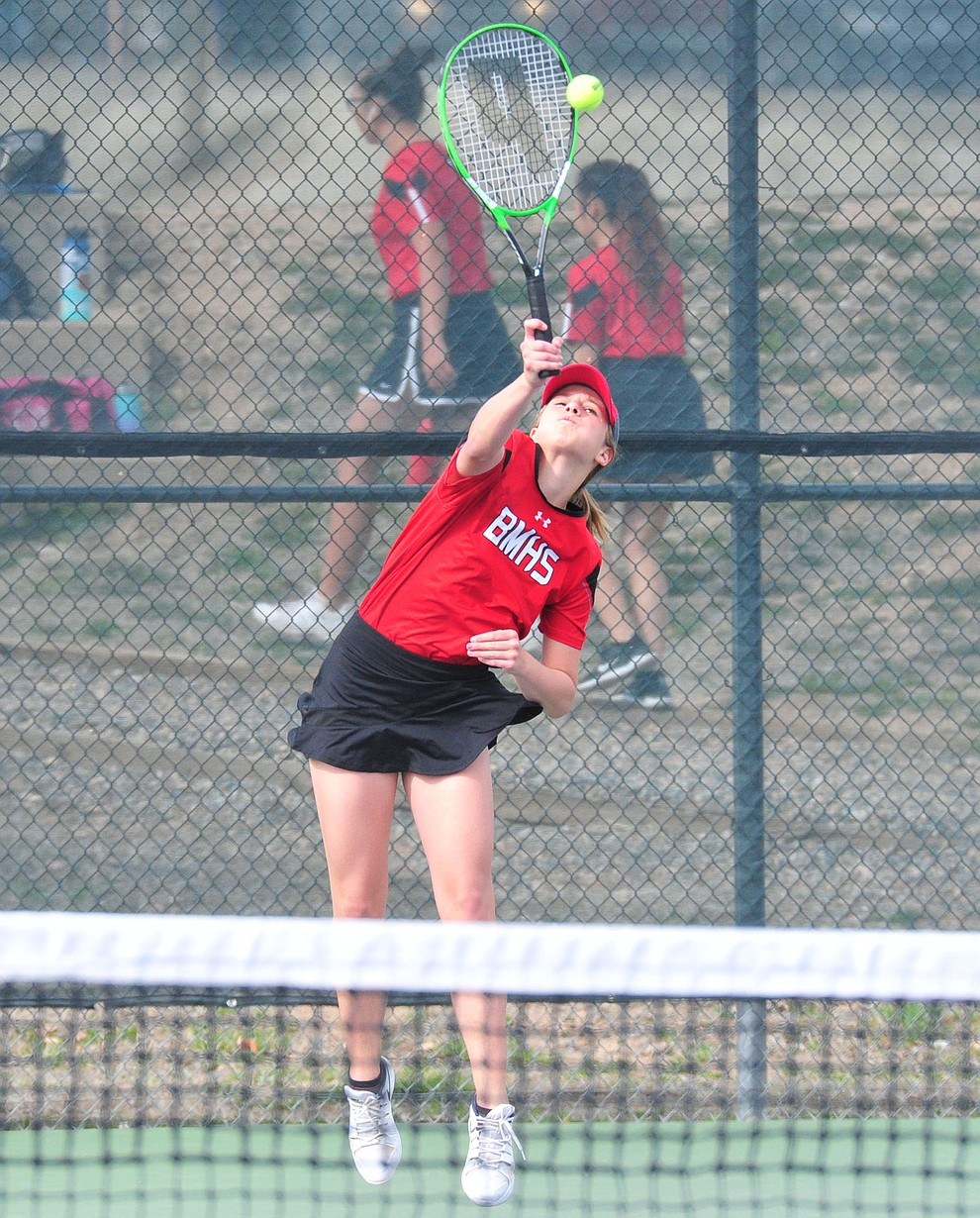 Bradshaw Mountain's Brinlee Kidd serves as the Bears traveled to Prescott for a girls tennis matchup Tuesday, March 26. (Les Stukenberg/Courier)