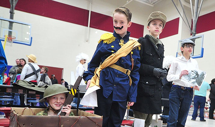 "Liberty Traditional seventh graders, from left, Dawson Chaney as Sgt. Alvin York, Mason Pearl as Kaiser Wilhelm II, Izae Vaca as Manfred Von Richtofen (the Red Baron), Caleb Johnson as Wilber Wright, pose as the school puts on its ""Living History Museum Night"" in Prescott Valley on Thursday, March 21, 2019. Approximately 65 students participated by dressing up and presenting facts as historical figures of their choosing. (Les Stukenberg/Tribune)"