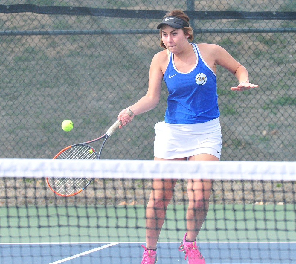 Prescott's Heidi Madsen hits a return as the Badgers hosted Bradshaw Mountain in girls tennis Tuesday, March 26. (Les Stukenberg/Courier)