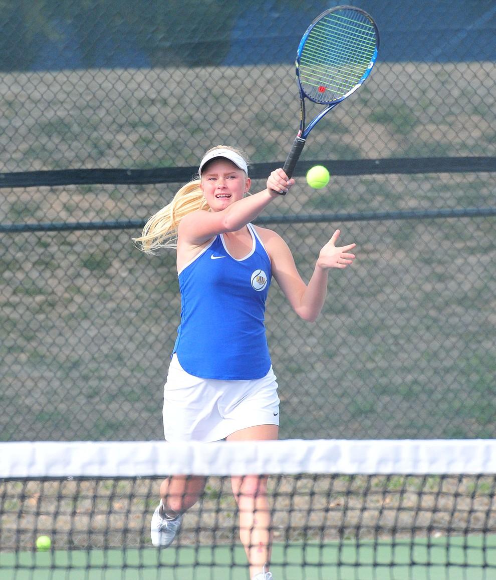 Prescott's Sierra McDonald hits a return as the Badgers hosted Bradshaw Mountain in girls tennis Tuesday, March 26. (Les Stukenberg/Courier)