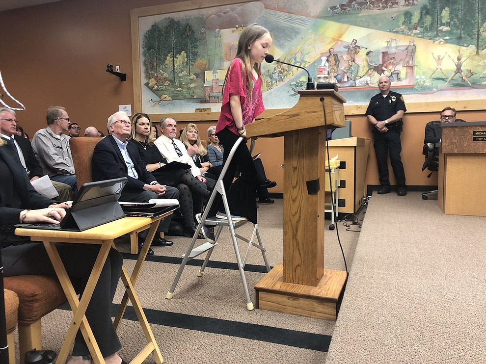 Third-grader Suli Sherman tells #PrescottCityCouncil that a survey she did shows that most locals & visitors support preserving the #GraniteDells at #PointofRocks. (Cindy Barks/Courier)