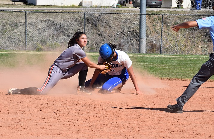 Aaliyah Alvarado attempts to tag out a runner during a game with Bagdad March 18. The Lady Vikes took the win, 13-3. (Wendy Howell/WGCN)