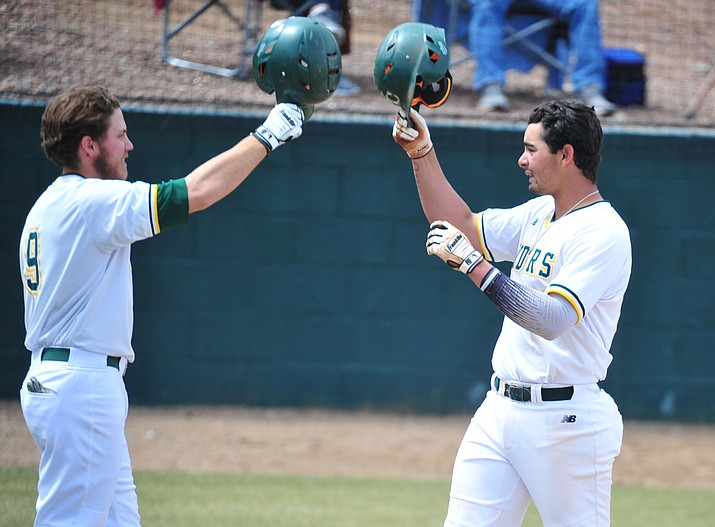 Yavapai College baseball player Christian Encarnacion-Strand gets congratulated by Tommy Sacco, left, after his fourth inning solo homer as the Roughriders take on Paradise Valley in their 2019 home opener Tuesday, March 26, 2019, in Prescott. (Les Stukenberg/Courier)