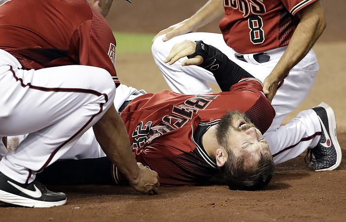 Arizona Diamondbacks' Steven Souza Jr. lies on the field after getting injured while scoring against the Chicago White Sox in the fourth inning of a spring training baseball game Monday, March 25, 2019, in Phoenix. (Elaine Thompson/AP)