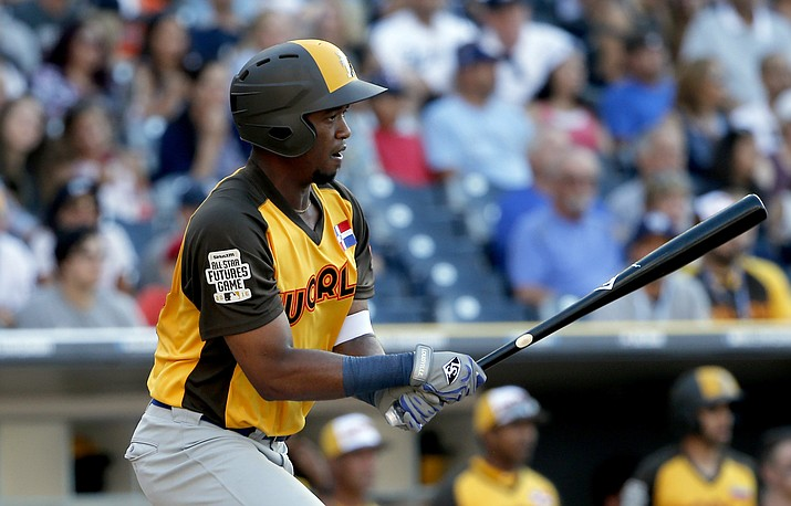 In this July 10, 2016, file photo, World Team's Eloy Jimenez hits against the U.S. Team during the seventh inning of the All-Star Futures baseball game in San Diego. A person familiar with the negotiations tells The Associated Press Wednesday, March 20, 2019, that the Chicago White Sox are nearing a $43 million, six-year contract with highly regarded outfield prospect Eloy Jimenez. (Lenny Ignelzi/AP, file)
