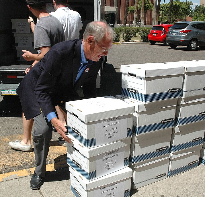 Former Attorney General Terry Goddard unloads boxes of petitions last year for to put a financial disclosure requirement into the Arizona Constitution. The measure fell short of valid signatures. Now Goddard has launched a new bid for 2020. (Capitol Media Services file photo by Howard Fischer)