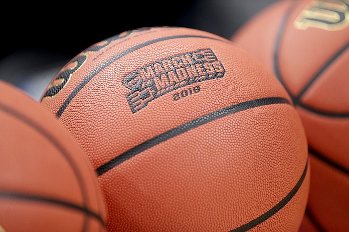 """This Wednesday, March 20, 2019, file photo shows a basketball with March Madness 2019 in a rack before Michigan practice at the NCAA college basketball tournament in Des Moines, Iowa. An Ohio man has made history with a March Madness bracket that's perfect through 48 games on the NCAA.com's """"Bracket Challenge,"""" according to the NCAA. (Nati Harnik/AP, file)"""